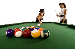 Pool models. Two beautiful models play pool / billiards Royalty Free Stock Photo