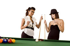 Pool models. Two beautiful models play pool / billiards Royalty Free Stock Images