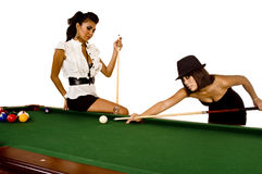 Pool models. Two beautiful models play pool / billiards Royalty Free Stock Image