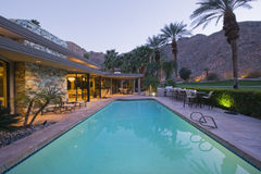 Pool And Modern Home Exterior Royalty Free Stock Images