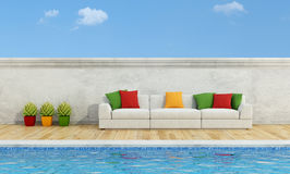 Pool with Modern sofa. White sofa with colorful pillows near a swimming pool- 3D Rendering Stock Photo