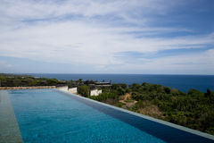 Pool on the mountain with view to the ocean Stock Photo