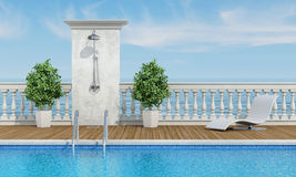 Pool near the sea with shower Royalty Free Stock Image