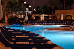 Pool by night. Lighted swimming pool at night Royalty Free Stock Images