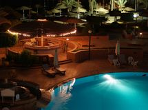 Pool by night. Lighted swimming pool at night Stock Images