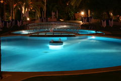 Pool at night stock photo