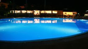 Pool at night in hotel`s territory stock footage