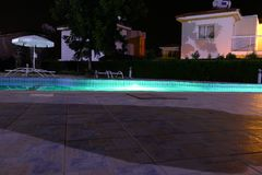 Pool with night lights at the resort.  Royalty Free Stock Images