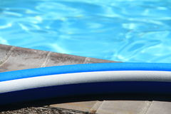 Pool noodle by the swimming pool Stock Photography