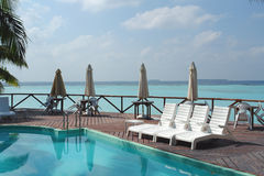 Pool over lagoon. Swimming pool over a lagoon at a resort in the Maldives royalty free stock photos