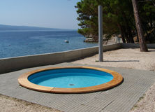 Pool over the sea in Croatia. Holiday resort with a pool over the sea, on the croatian beach Royalty Free Stock Photos