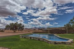 Pool overlooking the mountains of the Namibia desert. Africa stock photos