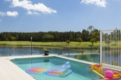 Pool overlooking waterfront golf course Stock Images