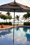 Pool parasol. Resorts area with pool view to the beach under the parasol Royalty Free Stock Photo