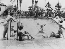 POOL PARTY. (All persons depicted are no longer living and no estate exists. Supplier grants that there will be no model release issues Stock Photo