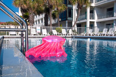 Pool and pink air mattress Royalty Free Stock Image
