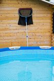 Pool with cleaning net Royalty Free Stock Image