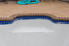 Pool plaster resurfacing Diamond Brite Detail. Empty pool remodel and repair work new Diamond Brite pool plaster being applied royalty free stock images
