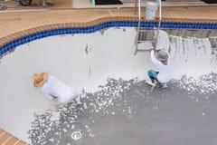 Pool plaster resurfacing Diamond Brite Detail. Empty pool remodel and repair work new Diamond Brite pool plaster being applied stock photo