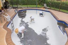 Pool plaster resurfacing Diamond Brite. Empty pool remodel and repair work new Diamond Brite pool plaster being applied royalty free stock image