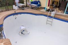 Pool plaster resurfacing Diamond Brite. Empty pool remodel and repair work new Diamond Brite pool plaster being applied royalty free stock photos
