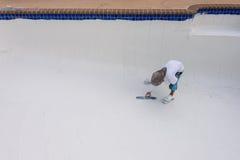 Pool plaster resurfacing Diamond Brite. Empty pool remodel and repair work new Diamond Brite pool plaster being applied stock photo