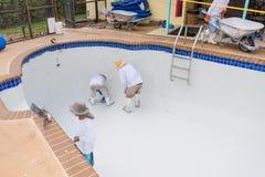 Pool plaster resurfacing Diamond Brite. Empty pool remodel and repair work new Diamond Brite pool plaster being applied stock image