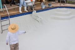 Pool plaster resurfacing Diamond Brite. Empty pool remodel and repair work new Diamond Brite pool plaster being applied stock images