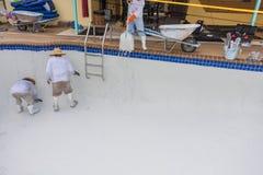 Pool plaster resurfacing Diamond Brite. Empty pool remodel and repair work new Diamond Brite pool plaster being applied royalty free stock photo