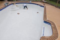 Pool plaster resurfacing Diamond Brite. Empty pool remodel and repair work new Diamond Brite pool plaster being applied stock photography