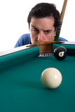 Pool player. Looking suspiciously to eight ball near corner pocket Stock Images