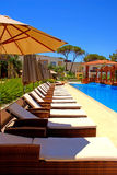 Pool with pool bed and umbrella in summer resort Royalty Free Stock Image