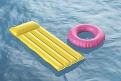 Pool raft and swim ring Stock Photos