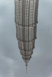 Pool reflected of bended Petronas twin towers in Kuala Lumpur, Malaysia Stock Photography