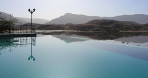 Pool with Reflection. At foot of mountain range Royalty Free Stock Photos