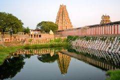 Pool with reflection of Virupaksha Hindu temple Stock Photo
