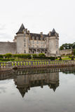 Pool reflections of  La Roche Courbon castle. La Roche Courbon  castle in charente maritime region of France Royalty Free Stock Images