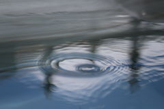 Pool reflections water rings rain drops Royalty Free Stock Photos