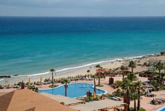 Pool resort and the ocean. This swimming pool in a spain resort in face at the ocean Stock Images
