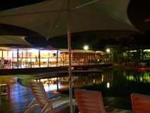 Pool and restaurant in night. Stock Image