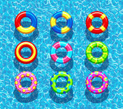 Pool rings on blue water background Stock Photo