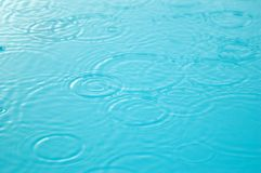 Pool of Ripples. Rain droplets cause ripples to form in the water in a pool Royalty Free Stock Image