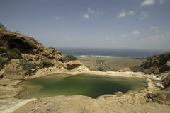 Pool on a rock, Dihamri Marine Protected Area, Socotra Island, Yemen. Pool on a rock, and ocean, sky, Dihamri Marine Protected Area, Socotra Island, Yemen stock image