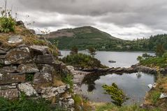 Pool in rocks at base of Castle Strome, Scotland. Royalty Free Stock Photography
