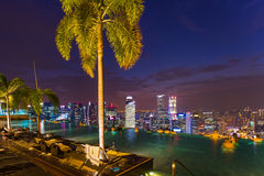 Pool on roof and Singapore city skyline Stock Image