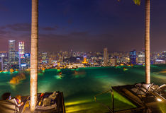 Pool on roof and Singapore city skyline Stock Images