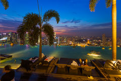 Pool on roof and Singapore city skyline Stock Photos