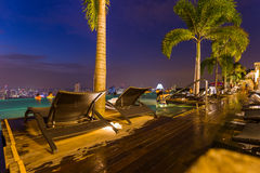 Pool on roof and Singapore city skyline Royalty Free Stock Image