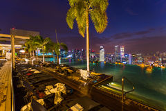 Pool on roof and Singapore city skyline Stock Photography