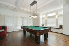 Pool room in luxury home Stock Photos